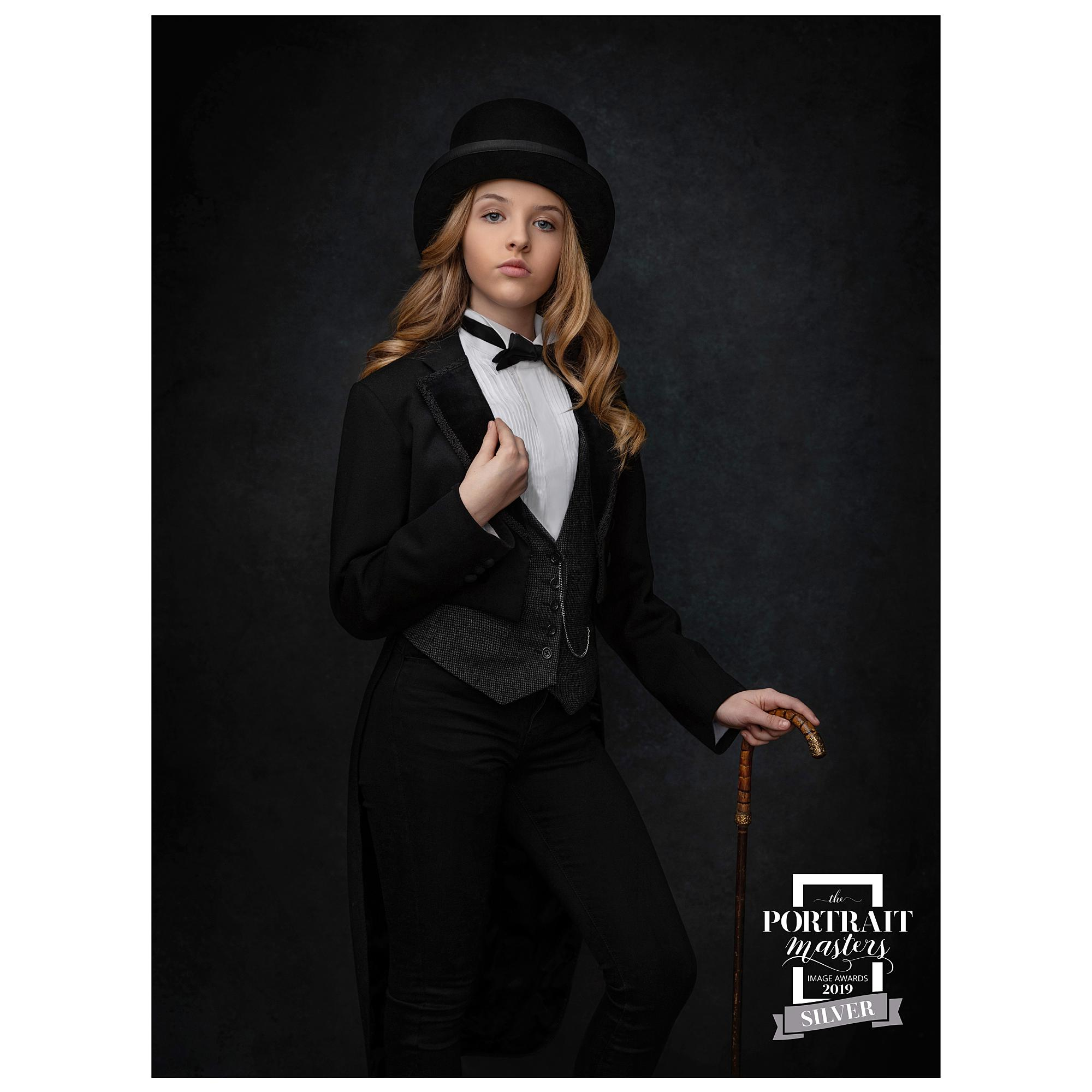 Portrait of a girl with a Black Top hat and Tails wins a silver award at the Portrait Masters