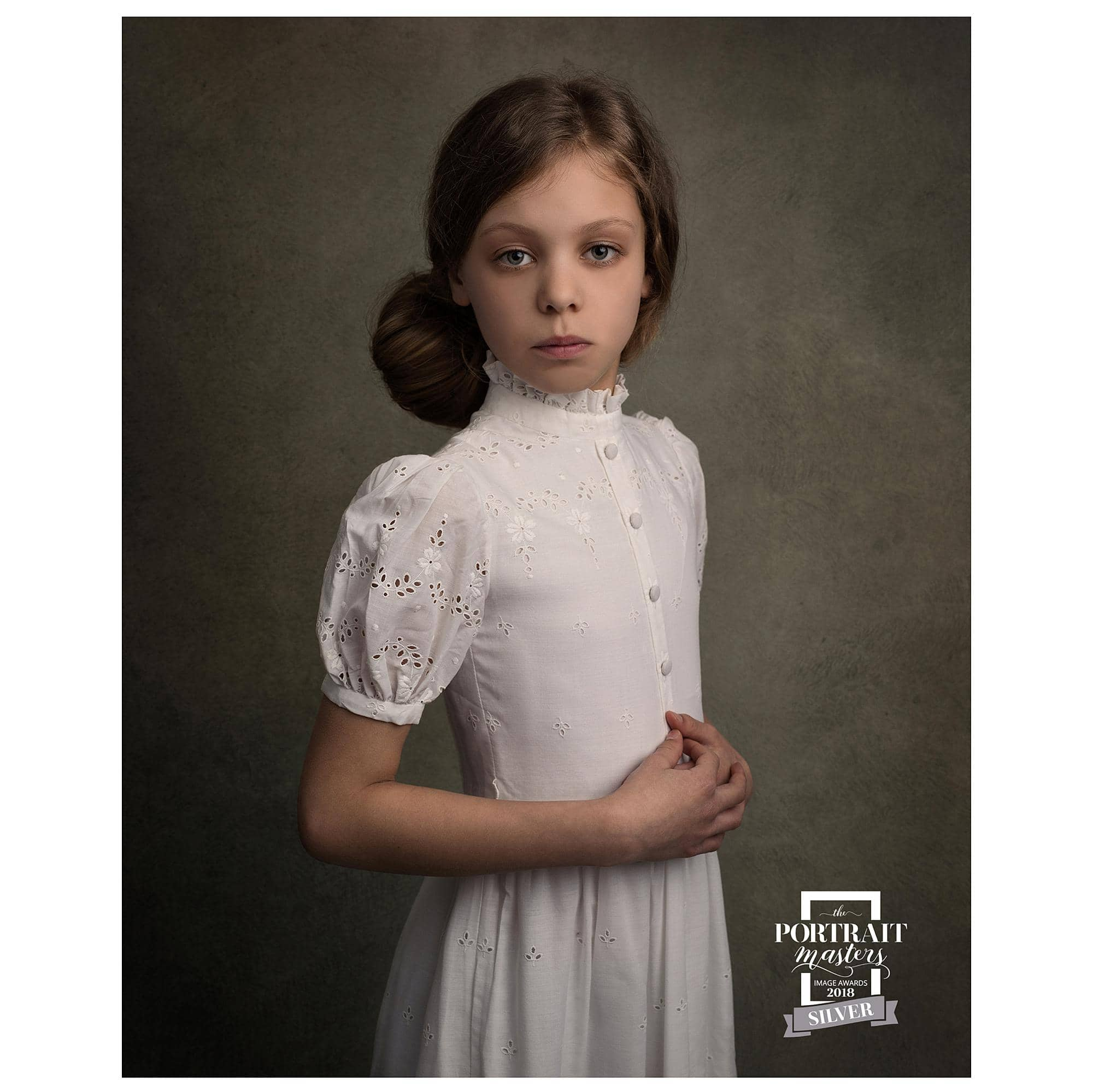 Fine Art Portrait of a Girl in a vintage white dress wins a Silver Award from the Portrait Masters