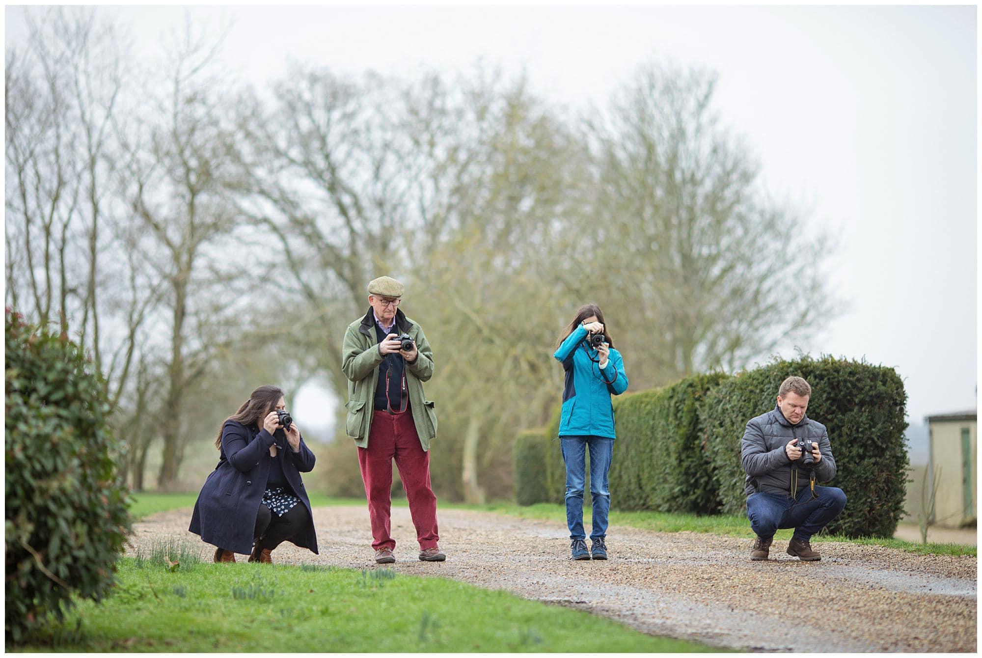 Four Photographers take photos with their camera's during a Beginners Photography Workshop in Stoke By Clare, Suffolk