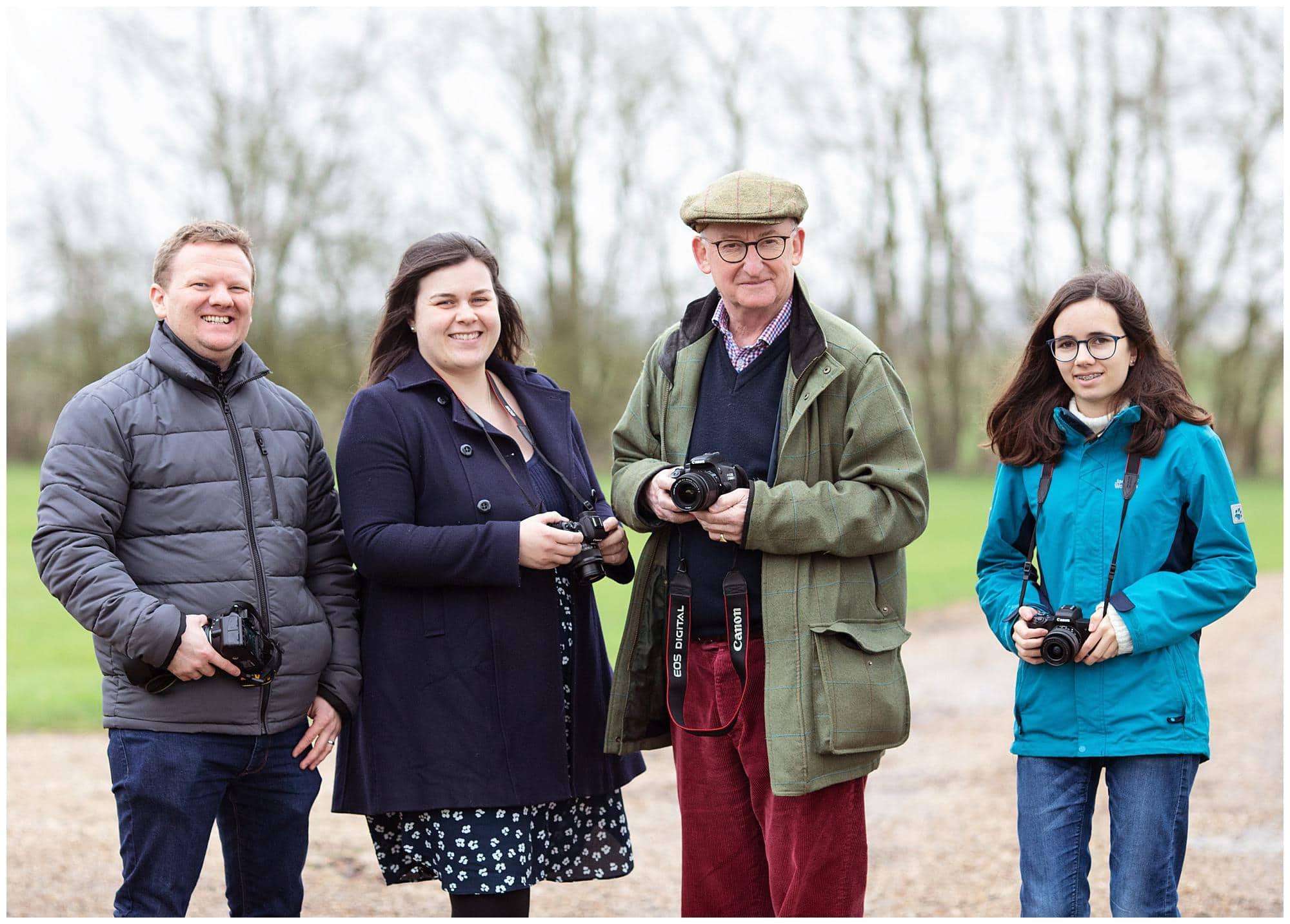 Four Photographers holding their camera's during a Beginners Photography Workshop in Stoke By Clare, Suffolk