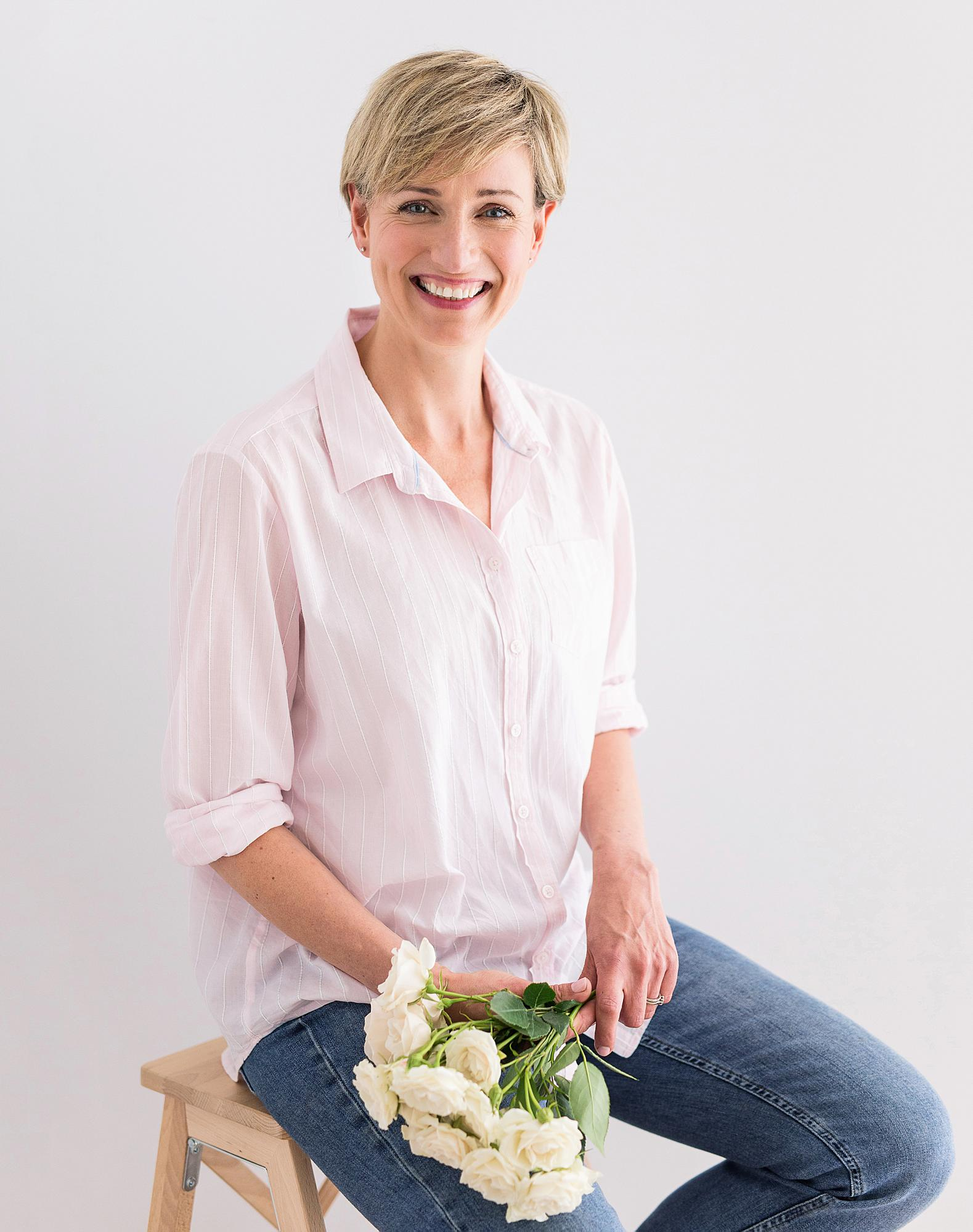 Personal Branding photo of a Florist holding roses in Suffolk studio