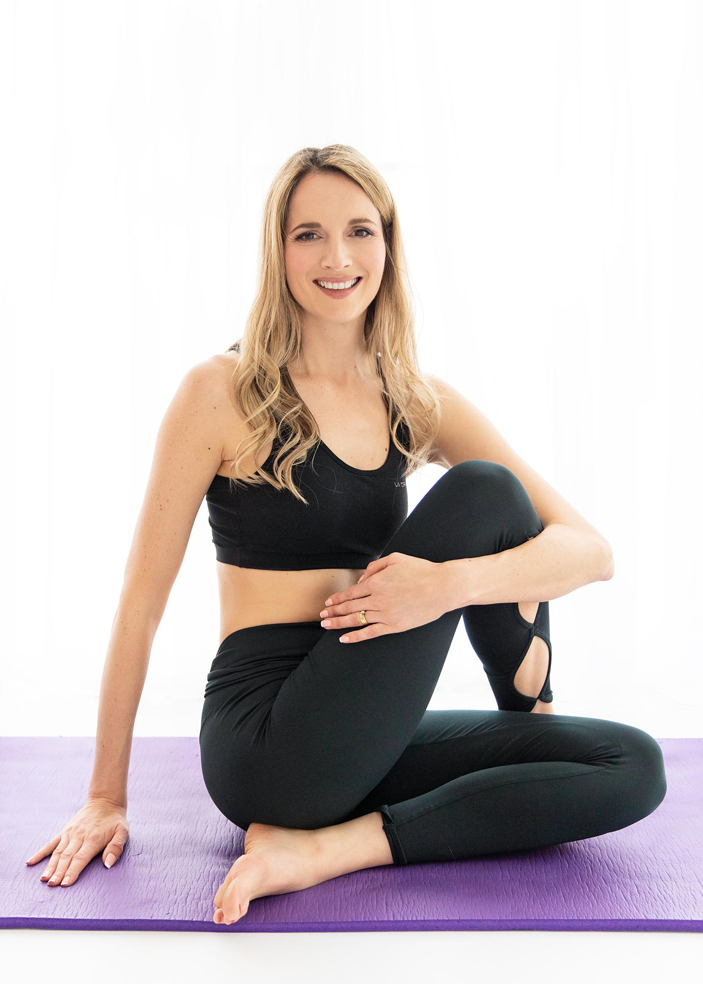 Pilates Teacher poses on a white background for a Personal Branding photoshoot in Sudbury, Suffolk