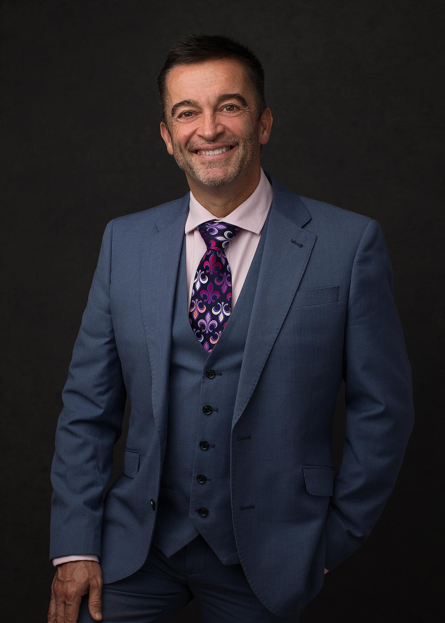 Man in a three piece suit smiles during a studio Personal Branding Photoshoot in Stoke By Clare, Suffolk