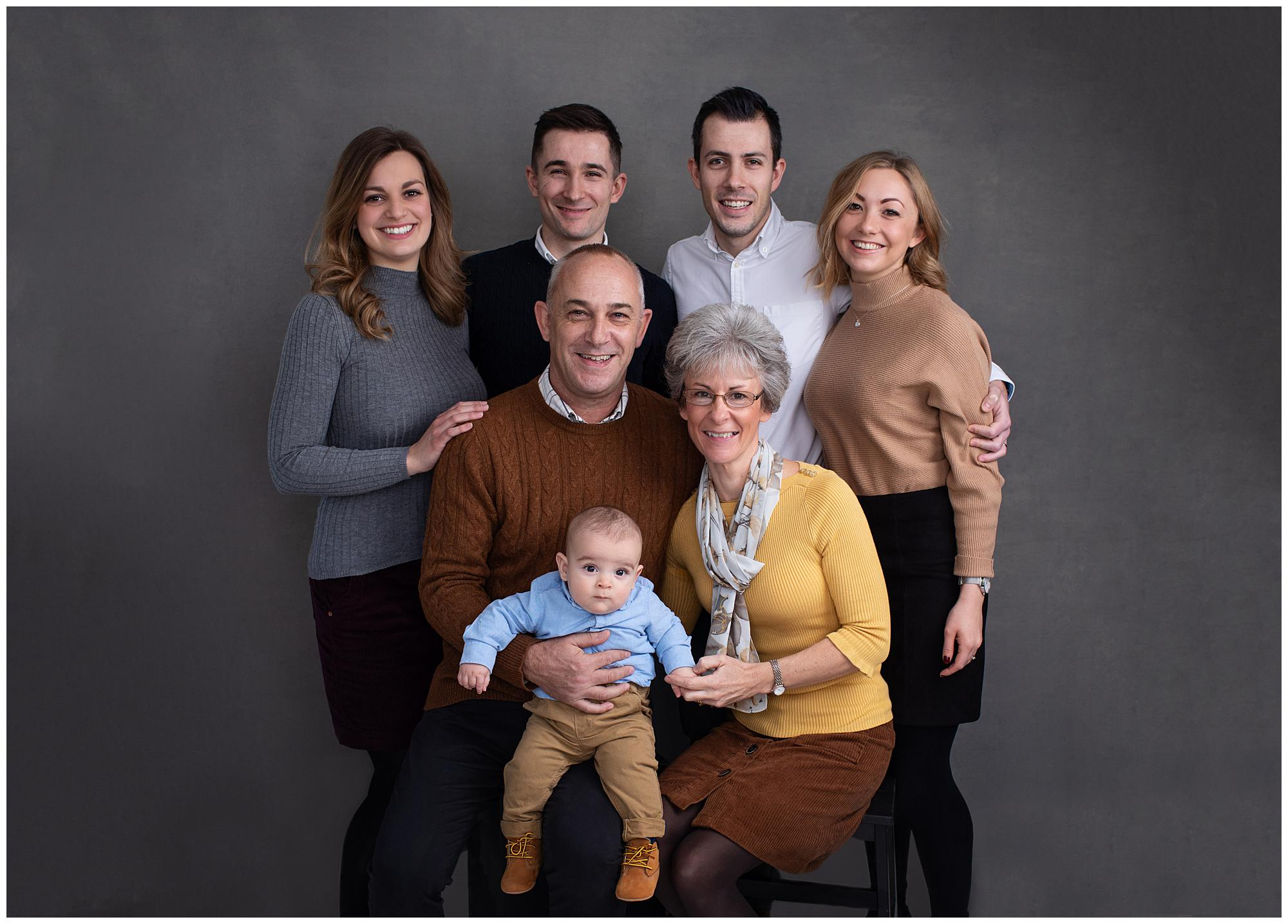 Extended Family Portrait on a grey background