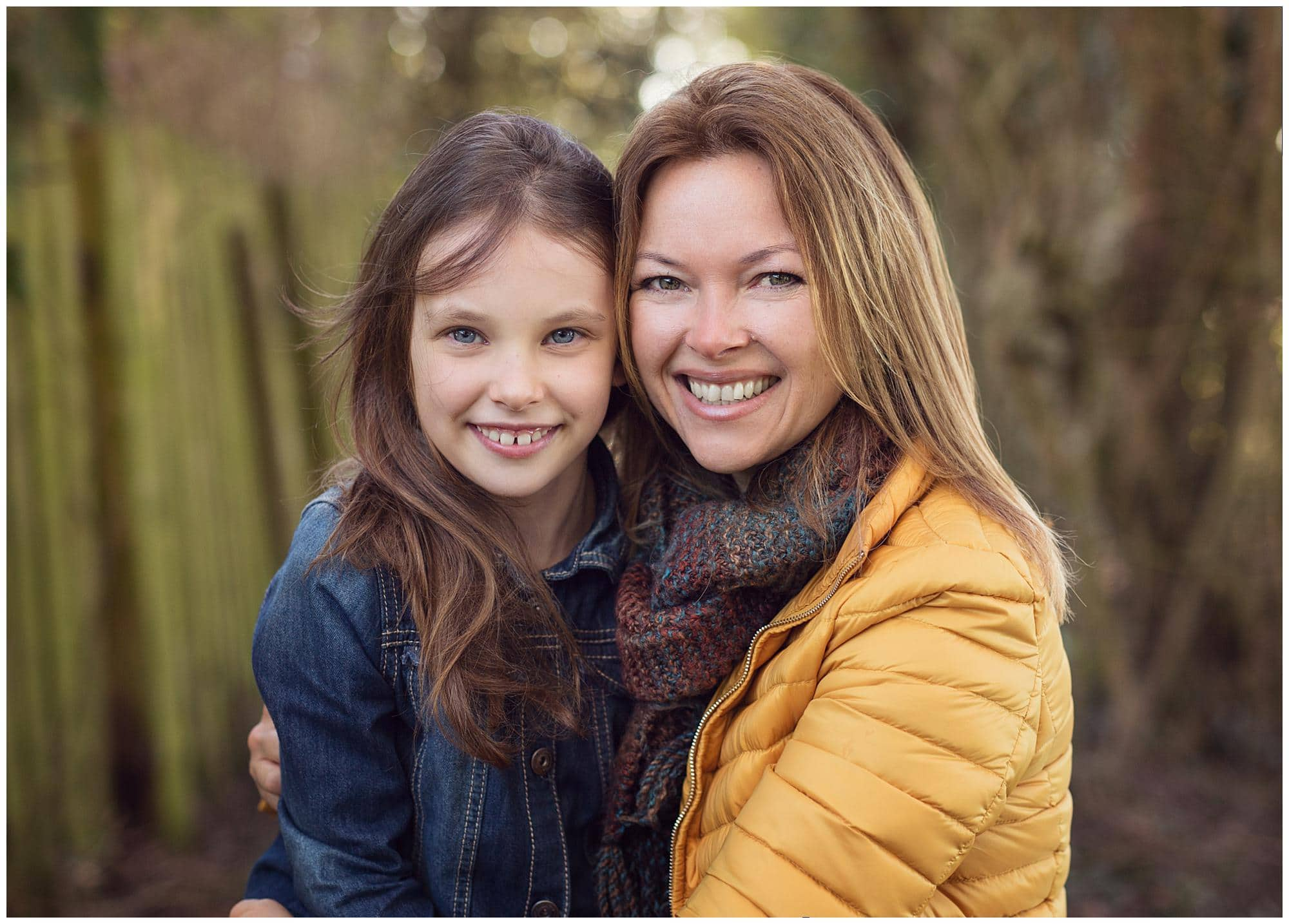 Mother and Daughter smiling on an outdoor family photoshoot in Suffolk