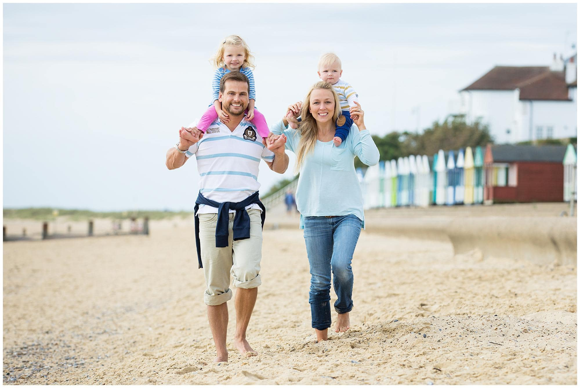 A family of four walking on the beach at Southwold, Suffolk