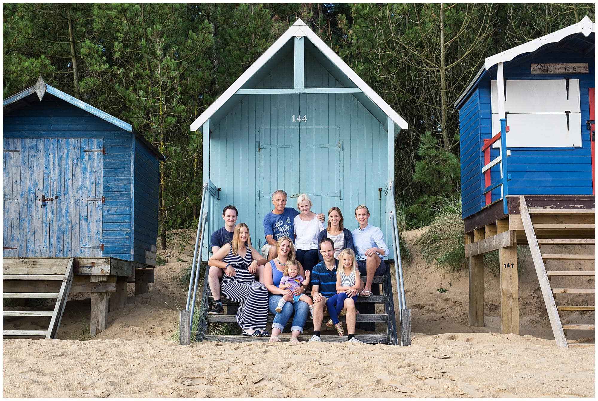 Extended Family Portrait in front of a beach hut in Suffolk