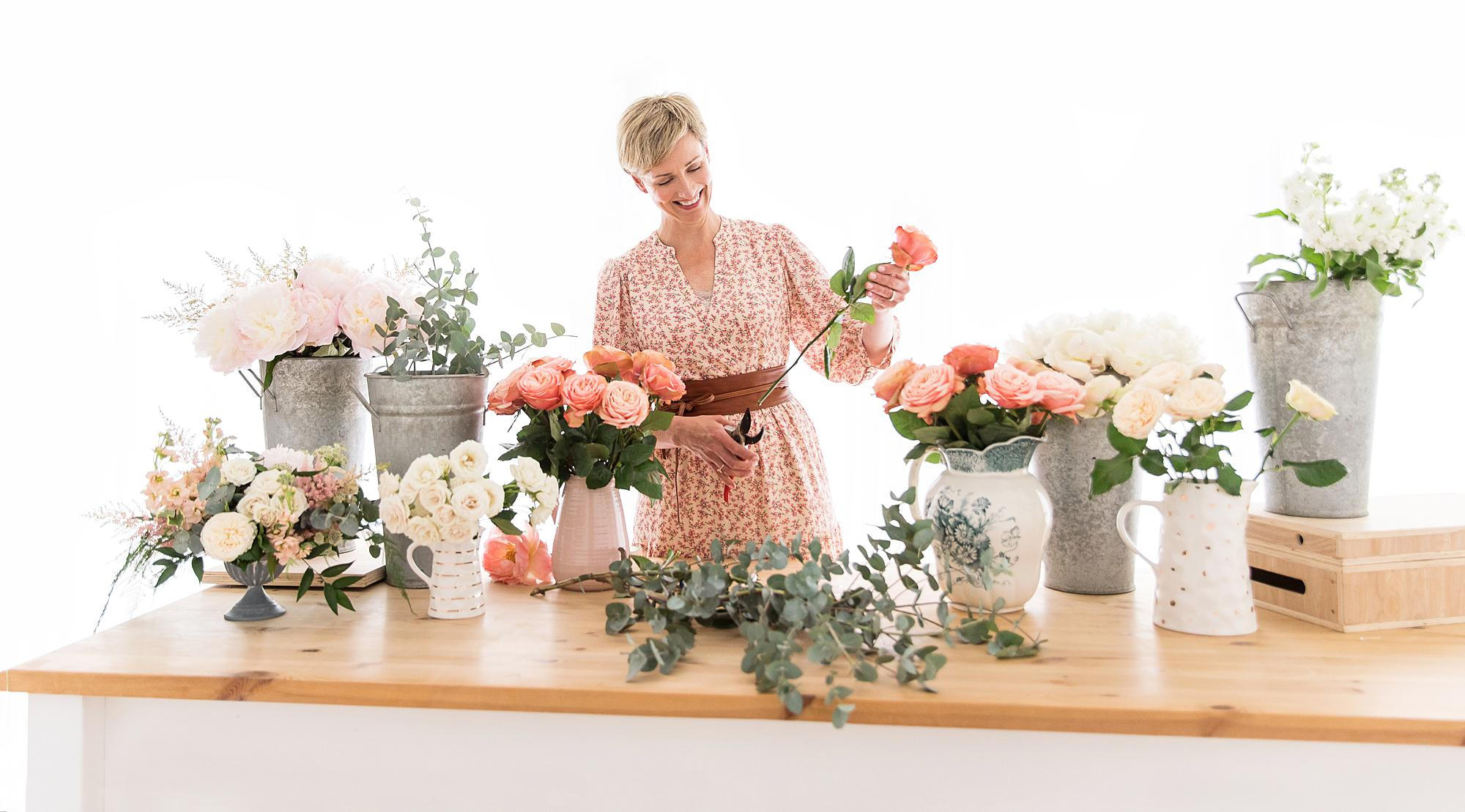 Florist cuts her roses during her Personal Branding Photoshoot