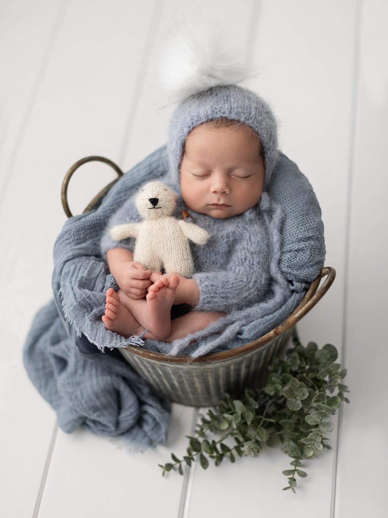 Baby boy in tin bucket during his Newborn Photoshoot in Suffolk Studio